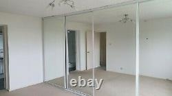 Large full height Mirrored fitted Wardrobe with four doors 4.4m wide with rail
