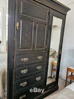 Large vintage tripple fronted black ornate wardrobe